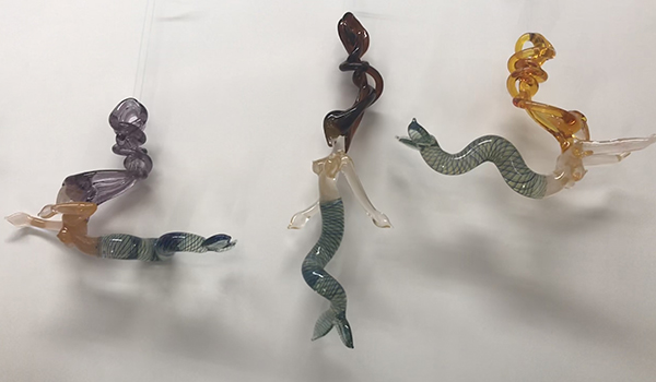 Hand blown glass mermaids sold by Red Fish Blue Fish in Hyannis, Massachusetts on Cape Cod
