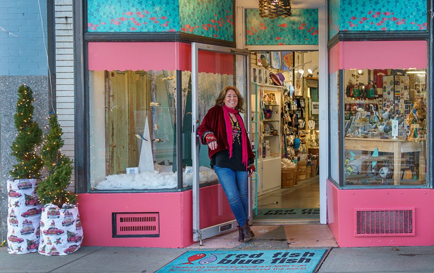 Jane Walsh, owner of Red Fish Blue Fish, a Gift Shop on Main Street in Hyannis on Cape Cod, standing in front of the store.